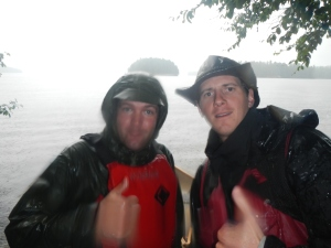 Mark and I caught in a down pour heading from Longer Lake to Big Trout Lake.
